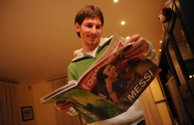 Leo Messi with France Football magazine